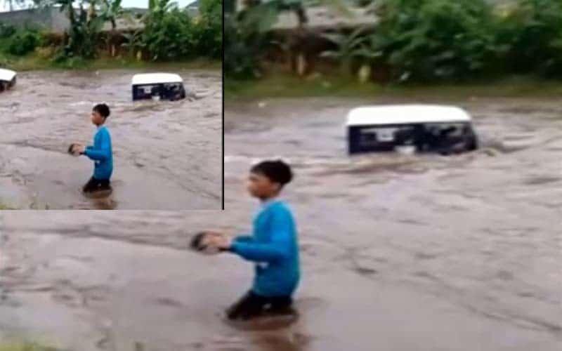 Setelah mengerahkan sejumlah kendaraan off road lainnya, salah satu mobil naas ini berhasil dinaikkan dari tengah arus banjir. Sedangkan satu kendaraan lainnya, masih menunggu arus banjir surut.